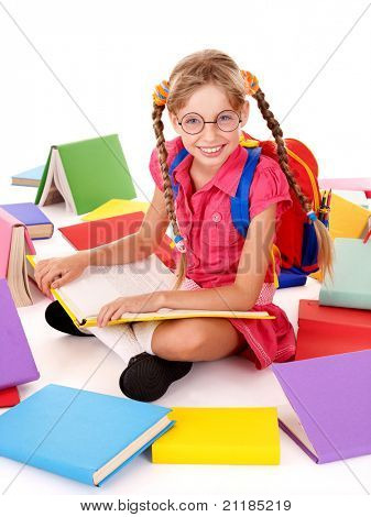 Happy sitting schoolgirl in eyeglasses  with  pile of books. Isolated.