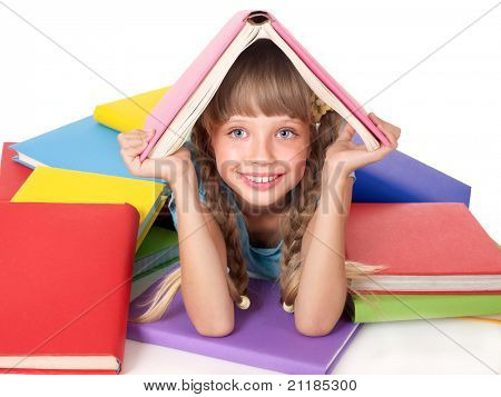 Little girl with pile of books on head. Isolated.