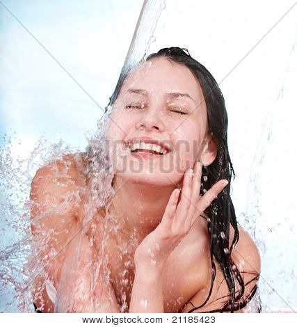 Beautiful young woman with wet hair. Beauty and fashion.