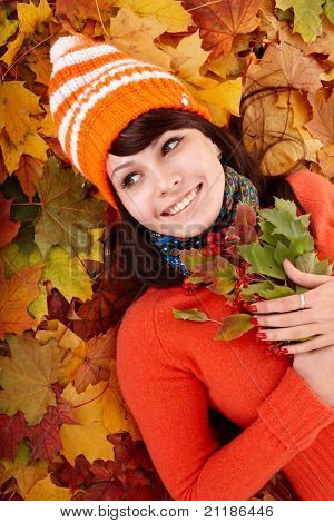 Girl in autumn orange leaves.  Outdoor.