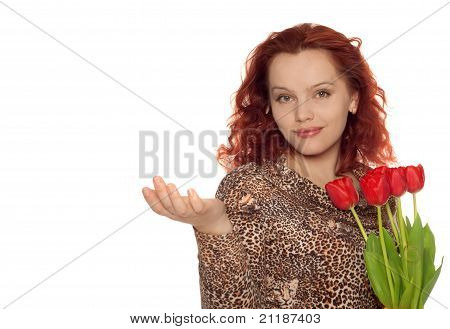 Attractive Smiling Woman With A Bouquet Of Tulips Holding Something.