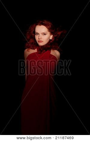 Glamour Portrait Redhaired Woman In A Red Dress On Black Background