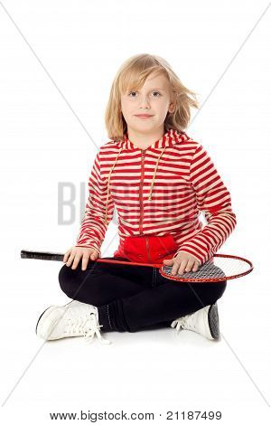 Pretty Girl Sitting On The Floor With A Tennis Racket