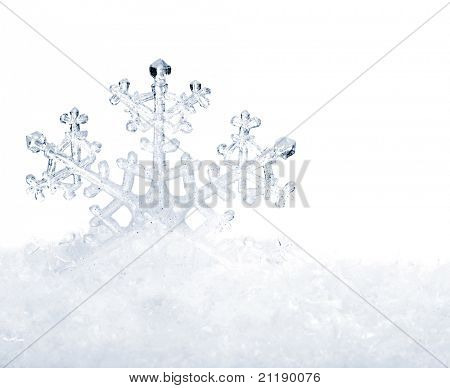 Snowflake in white snow. Isolated.