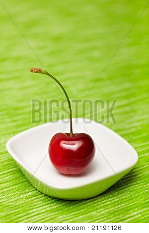 Single Cherry In A Bowl