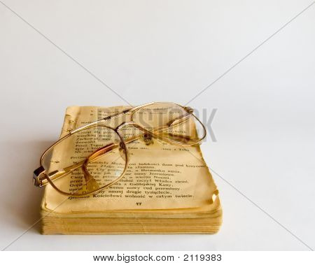 Old Prayer Book And Glasses