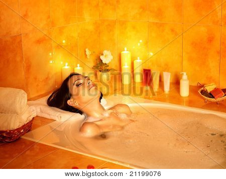 Young woman take bubble  bath.