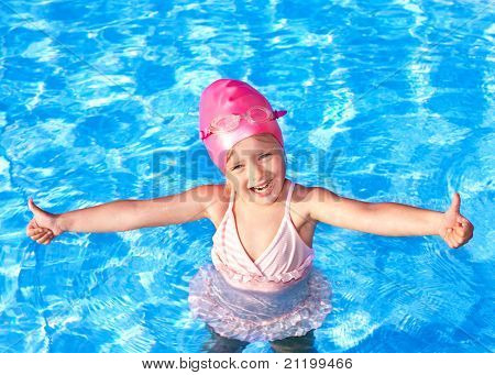 Thumb up of child in swimming pool.
