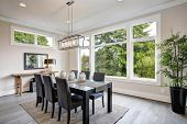 Luxurious Modern Dining Room Boasts A Black Dining Table poster