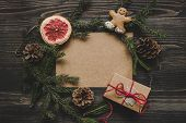 Christmas Background. Christmas Decoration With Fir Branches And Christmas Gift On The Wooden Table poster
