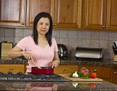 Asian Mom Cooking At Home