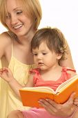 picture of happy kids  - Young mother with her daughter reading book at home - JPG