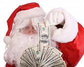 stock photo of santa claus hat  - Santa Claus holding money - JPG