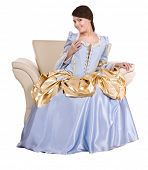 image of marquise  - Girl in old  long blue with gold dress on armchair - JPG
