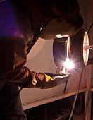 pic of tig  - A journeyman welder tig welding pipe in shop - JPG