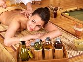 foto of thai massage  - Young woman getting massage in bamboo spa - JPG
