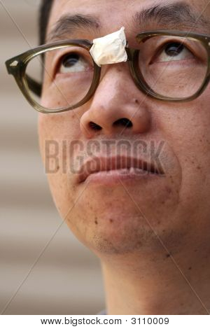 Asian Man In Broken Glasses