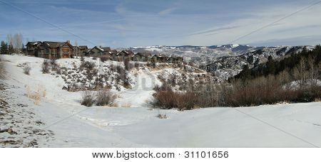 Large Houses Overlook Snowy Valley