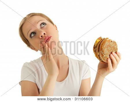 Hungry Beautiful Girl Eats A Tasty Hamburger An Isolated