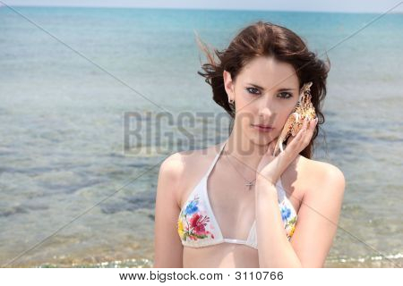 Beautiful Teen Girl On The Beach