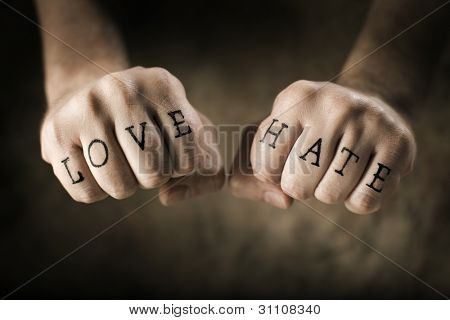 Man with (fake) Love and Hate tattoos on his hands.