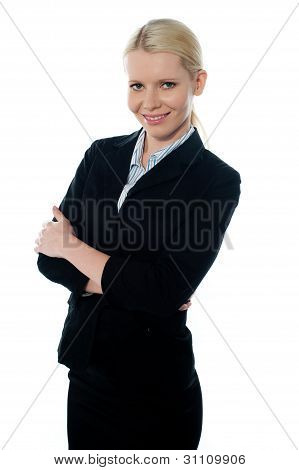 Smiling Young Femlae Ceo Posing With Folded Arms