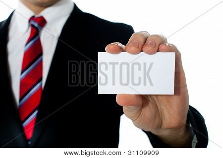 Closeup Shot Of A Man Showing Business Card