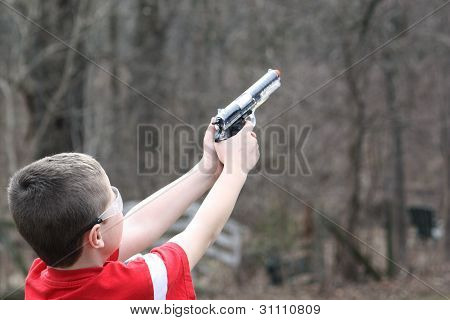 Boy Shooting at High Target