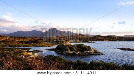 poster of Wetlands And Barrens On The Coast, Coastline And Islands With Mountains Range In A Distance, Moody B