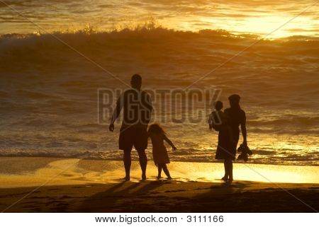 Family Sunset At The Beach