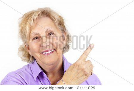 Pretty Senior Woman Pointing