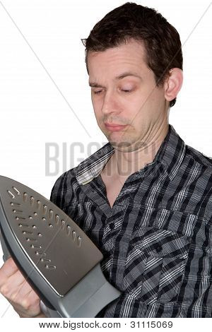 Man Looking On A Iron And Wondering