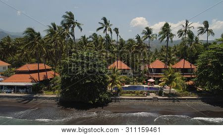 poster of Aerial View Luxury Hotel With Swimming Pool, Sun Beds, Palm Trees By Sea. Seascape Coastline With Bl
