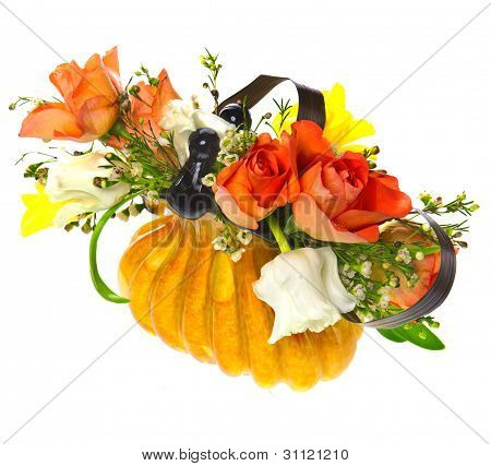 orange roses and tulips in the vase