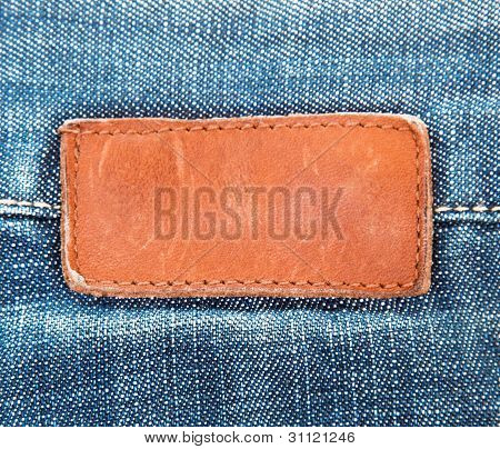 blank leather jeans label sewed on blue jeans