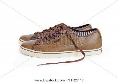 Two Brown Sneakers Isolated On White Background