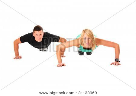 A picture of a young couple doing push-ups over white background