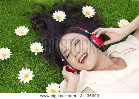 Happy Woman Listens To Music Outdoor