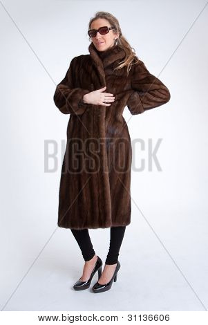 Young woman with mink coat and sunglasses