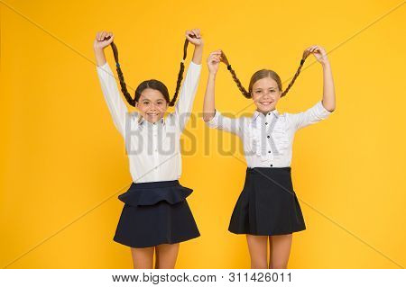 Long Hair Growth Stimulant. Cute Small Children Holding Long Hair Braids On Yellow Background. Adora poster