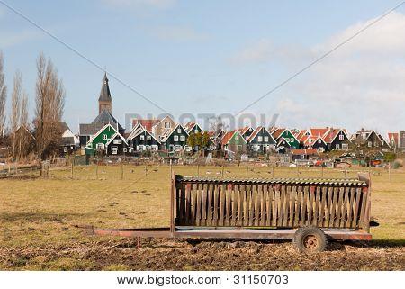 Farmers wagon in front of typical Dutch village Marken