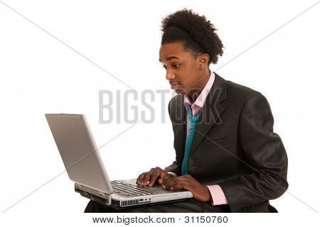 Young black business man surprised by the laptop