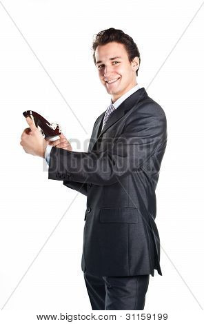 Young businessman with women's shoes