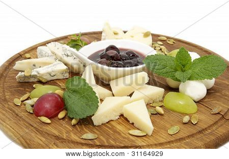 cheese on a wooden plate
