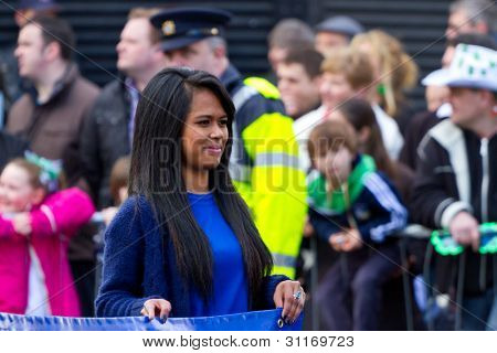 LIMERICK, IRELAND - MARCH 17: Unidentified girl participates in a parade for St. Patrick's Day. It's a traditional Irish holiday celebration. March 17, 2012 in Limerick, Ireland.