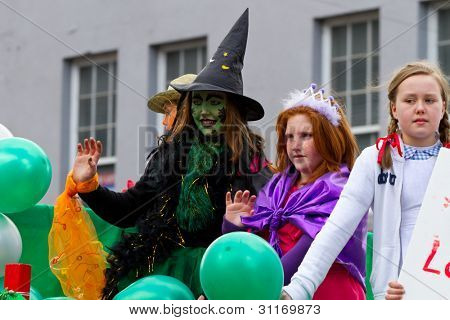 LIMERICK, IRELAND - MARCH 17: Unidentified people participate in a parade for St. Patrick's Day. It's a traditional Irish holiday celebration. March 17, 2012 in Limerick, Ireland.