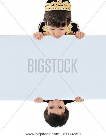 Two kids holding white banner