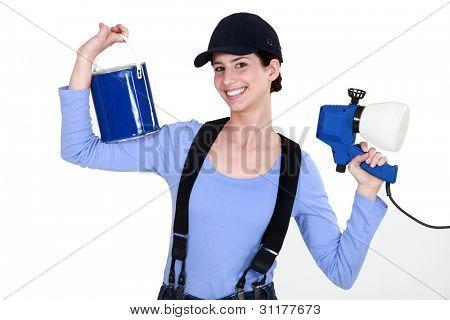 Woman holding paint sprayer
