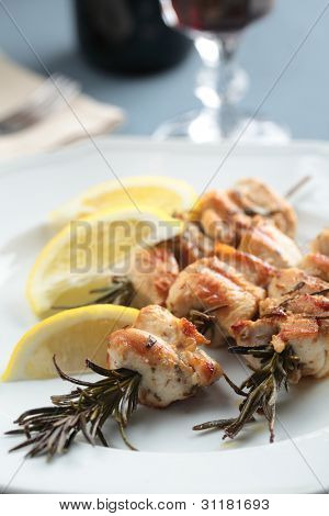 Chicken souvlaki on rosemary branches with lemon