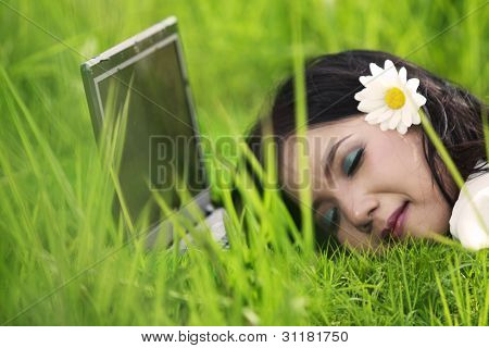 Pretty Woman Sleeping On Laptop Outdoor